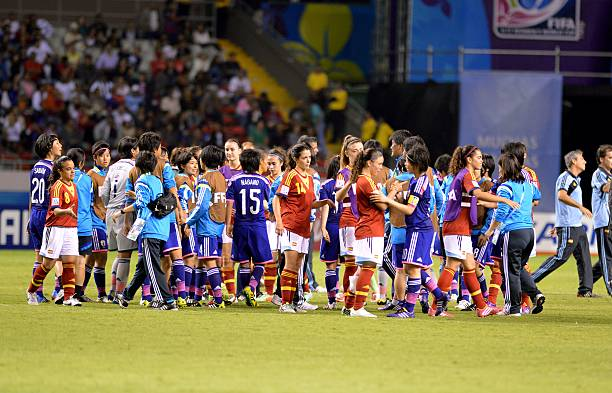 The japanese and spanish players greet each other at the end of the japanese and spanish players greet each other at the end of their fifa u 17 womens world cup costa rica 2014 final match at the national stadium in m4hsunfo