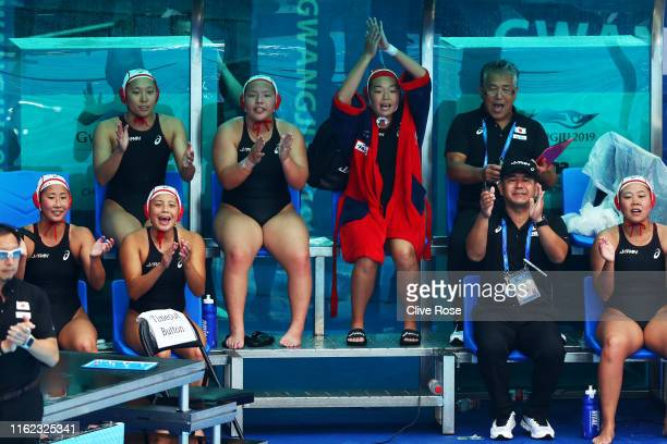 The Japanese bench celebrates a play against Italy during their Women's Water Polo Preliminary round match on day four of the Gwangju 2019 FINA World...