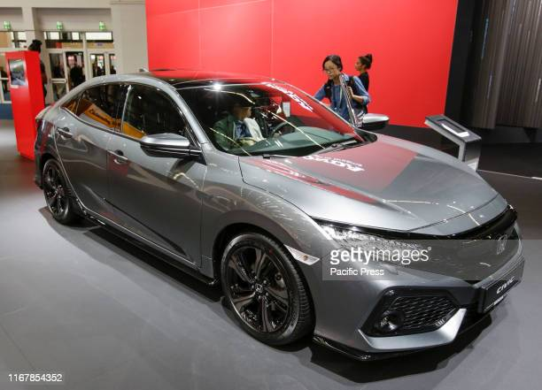 The Japanese car manufacturer Honda displays the Honda Civic at the 2019 Internationale Automobil-Ausstellung .