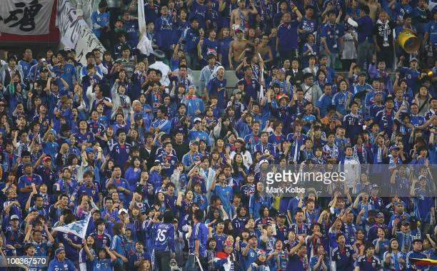The Japanese crowd get behind their team during the international friendly match between Japan and South Korea at Saitama Stadium on May 24 2010 in...