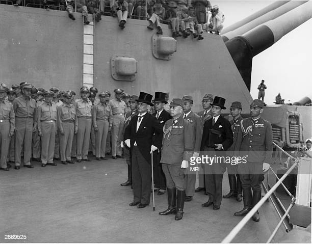 The Japanese delegation arrives on board the USS Missouri in Tokyo Bay to sign the Instrument of Surrender headed by Mamoru Shigemitsu the tophatted...