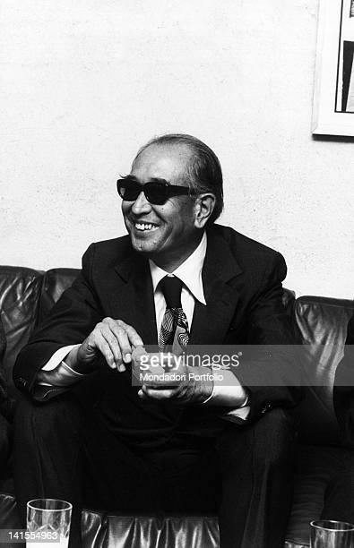 The Japanese director Akira Kurosawa smiling seated on a divan Milan 1976