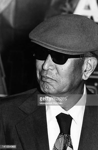 The Japanese director Akira Kurosawa wearing a hat Milan 1976