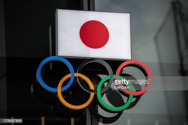 The Japanese flag is displayed over the Olympic Rings on October 13, 2020 in Tokyo, Japan. Despite assurances from senior International Olympic...