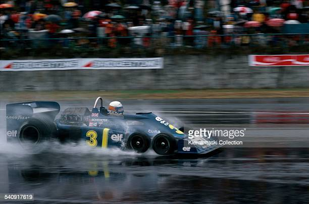 The Japanese Grand Prix Fuji October 17 1976 Jody Sheckter in the Team Tyrrell 34 in the wet n spite of that extra traction in front he had to retire...