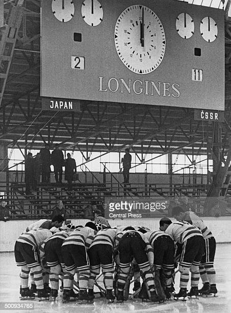 The Japanese Ice Hockey team gathers together to discuss tactics during the match against Czechoslovakia at the Winter Olympics Innsbruck Austria...