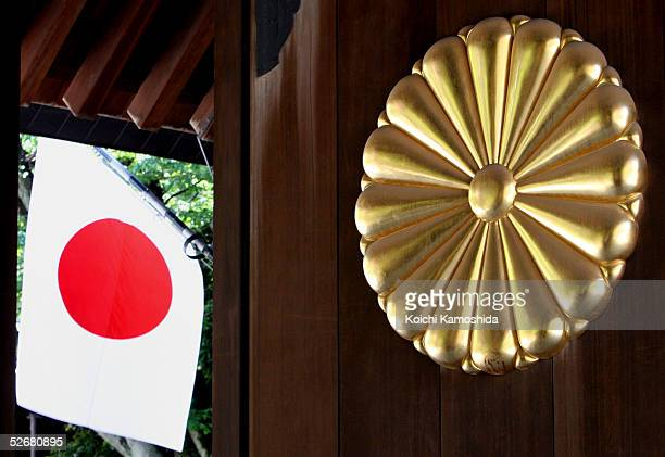 The Japanese Imperial crest based on the Chrysanthemum is seen beside the national flag at the annual spring festival held at the Yasukuni Shrine on...