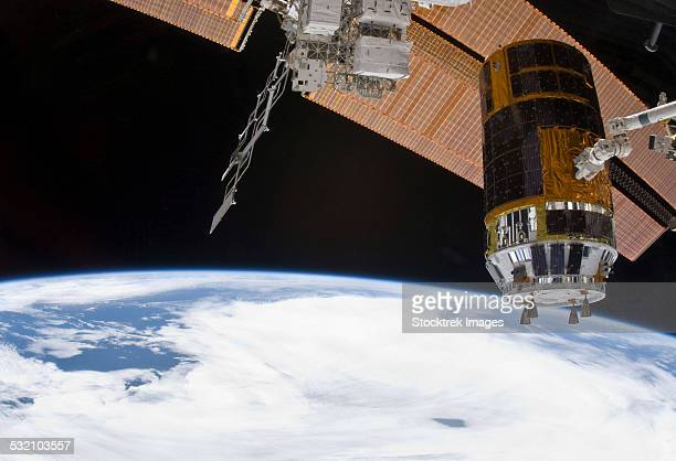 The Japanese Kounotori H-II Transfer Vehicle in the grasp of Canadarm2.