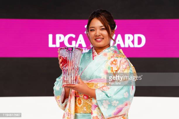 The Japanese LPGA Regular Tour Prize Money Queen Ai Suzuki poses with the trophy during the LPGA Awards on December 18 2019 in Tokyo Japan