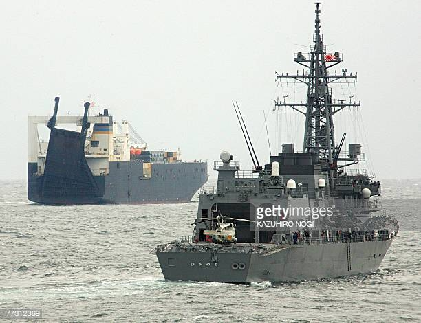 The Japanese Maritime SelfDefense Force destroyer Ikazuchi approaches the target ship the US naval transport ship 1st Lt Harry Martin during...