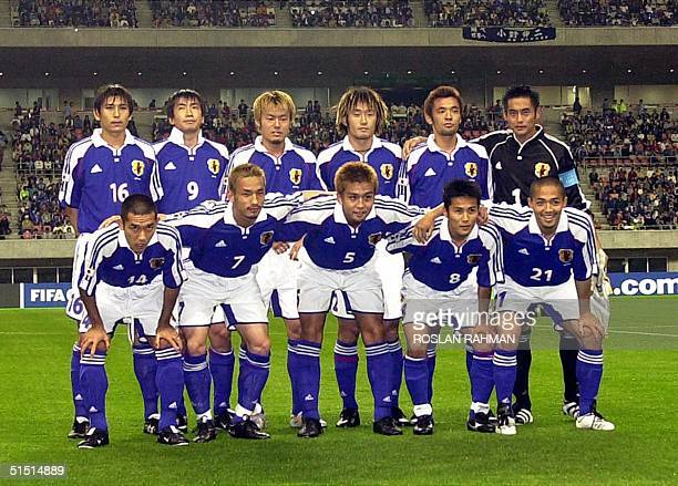 The Japanese national soccer team poses before its Confederation Cup match against Canada 31 May 2001 in Niigata Standing from L Koji Nakata Akinori...
