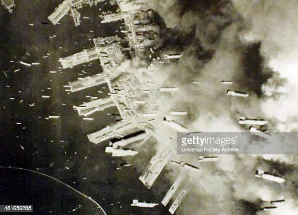 The Japanese port of Kobe is bombed by US aircraft in March 1945.