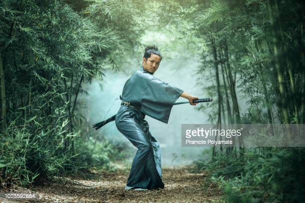 the japanese samurai are gripping the sword, preparing to fight. - samurai stock pictures, royalty-free photos & images