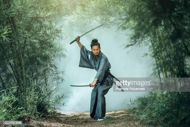 the japanese samurai are gripping the sword, preparing to fight. - ninja fotografías e imágenes de stock