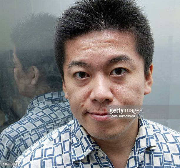 The Japanese software distributor livedoor Co President CEO Takafumi Horie sits at an office desk on July 152004 in Tokyo Japan Livedoor is a...