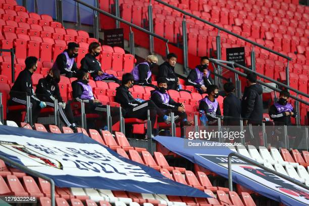 The Japanese substitutes take their seats in the stand during the international friendly match between Japan and Cameroon at Stadion Galgenwaard on...