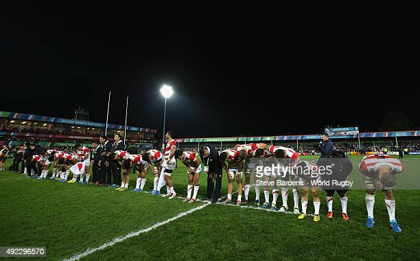The Japanese team celebrate after the 2015 Rugby World Cup Pool B match between USA and Japan at Kingsholm Stadium on October 11 2015 in Gloucester...