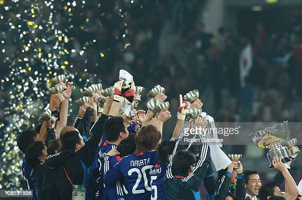 The Japanese team celebrate after they defeated Australia in extra time 1-0 at the AFC Asian Cup Final match between the Australian Socceroos and...