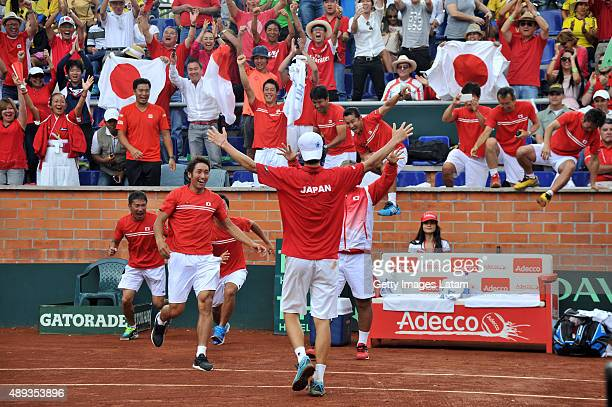 The Japanese team celebrates after defeating the Colombian team during the Davis Cup World Group Playoff at Club Campestre on September 20 2015 in...