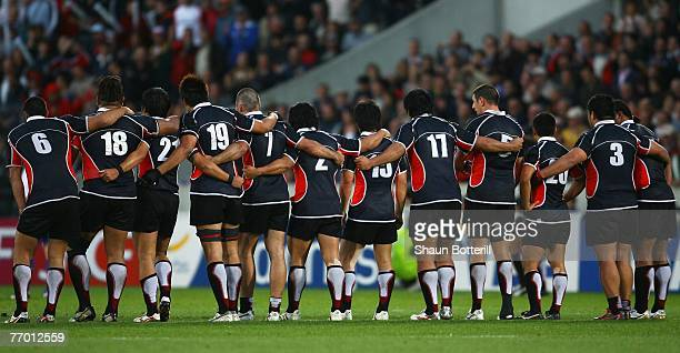 The Japanese team huddle as teammate Shotaro Onishi lines up a conversion to tie the scores in second half injury time during the Rugby World Cup...