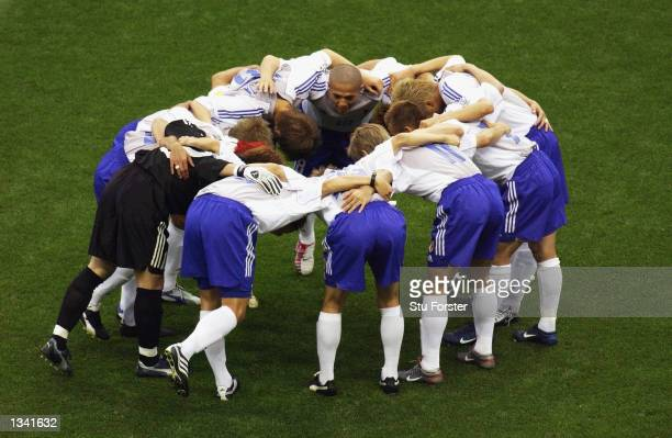 The Japanese team huddle before the Group H match of the World Cup Group Stage against Belgium played at the Saitama Stadium SaitamaKen Japan on June...