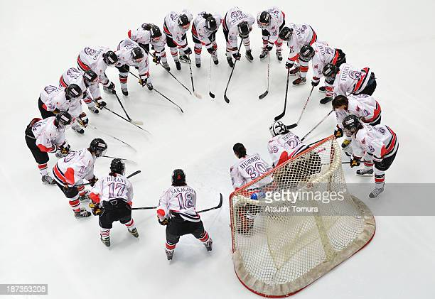 The Japanese team in huddle at the goal before the Japan and Slovakia match during day two of the Ice Hockey Women's 5 Nations Tournament at the Shin...
