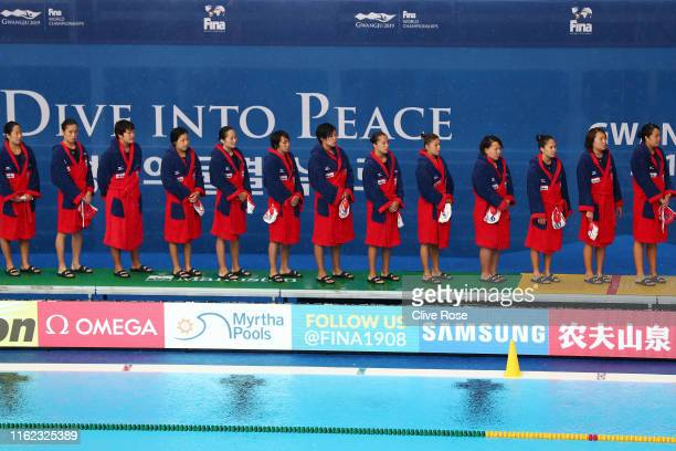 The Japanese team stands for the national anthem prior to their Women's Water Polo Preliminary match against Italy on day four of the Gwangju 2019...