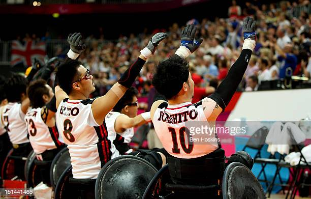 The Japanese team wave to the crowd after winning the Men's Pool Phase Group A match between Great Britain and Japan on day 9 of the London 2012...