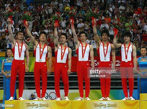 The Japanese team with Takehiro Kashima Takuya Nakase Makoto Okiguchi Koki Sakamoto Hiroyuki Tomita and Kohei Uchimura celebrate the silver medal in...