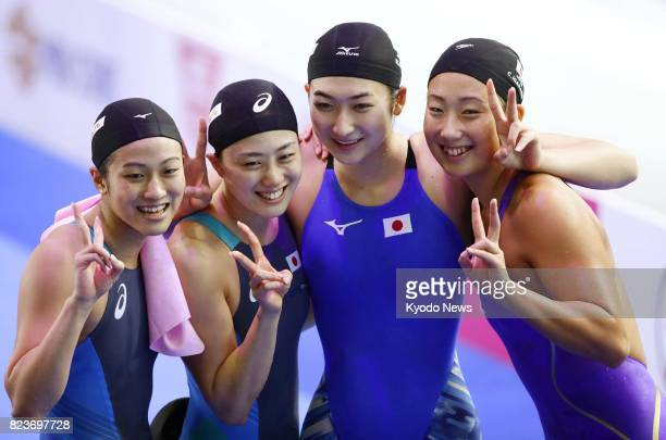 The Japanese women's 4x200meter freestyle relay team Aya Takano Tomomi Aoki Rikako Ikee and Chihiro Igarashi pose for photos on July 27 after...