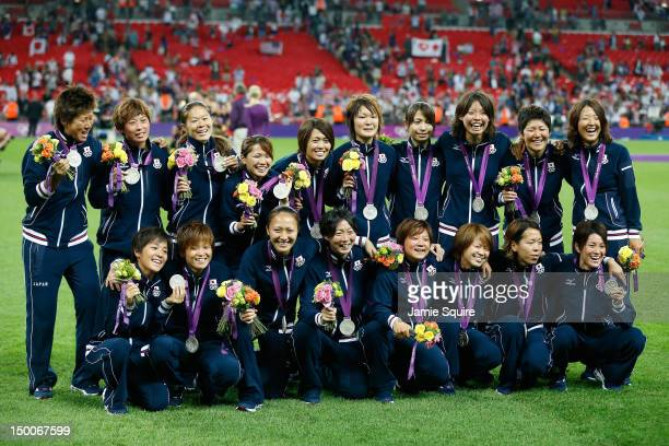 The Japanese women's football team poses with the silver medal after the Women's Football gold medal match on Day 13 of the London 2012 Olympic Games...