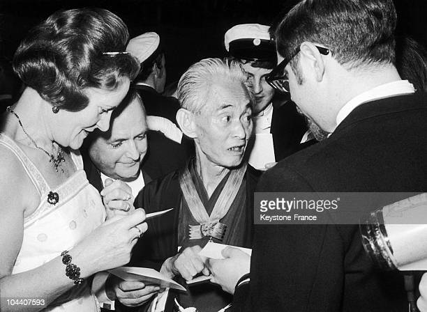 The Japanese writer Yasunari KAWABATA signing autographs on a dinner organized to celebrate the Nobel Litterature Prize winner in Stockholm City Hall...