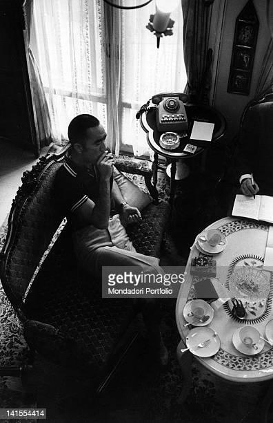 The Japanese writer Yukio Mishima sitting in a living room during an interview Tokyo March 1970