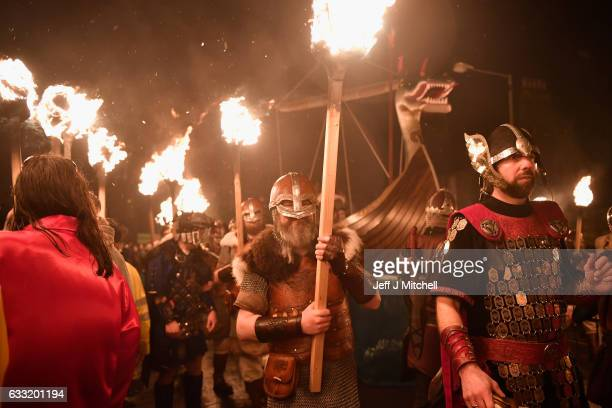 The Jarl squad begin to light torches at the culmination of Up Hell Aa on January 31 2017 in Lerwick Shetland The traditional festival of fire known...