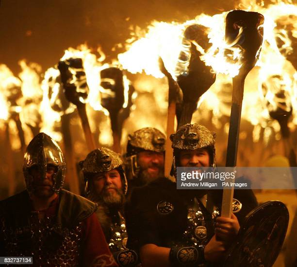 The jarl squad march through the streets of Lerwick at night prior to the burning of the galley during Up Helly Aa