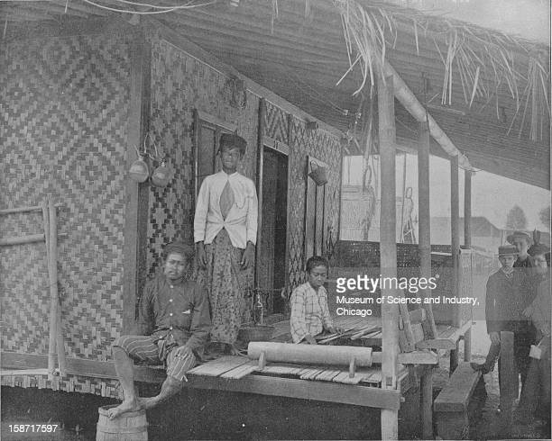 The Javanese House Builders at the World's Columbian Exposition in Chicago Illinois 1893 This image was published in the 'Portfolio of Photographs of...