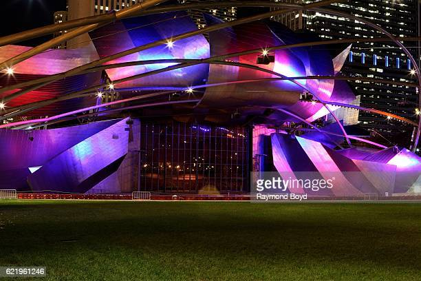 The Jay Pritzker Pavilion lights up blue and red to celebrate the Chicago Cubs' world series win against the Cleveland Indians in Chicago Illinois on...