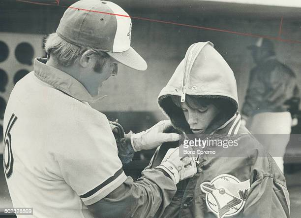 The Jays' Senior Citizen 38yearold infielder Ron Fairly gives a few warmup instructions to his son Mike 11 during team's workout yesterday Toronto's...