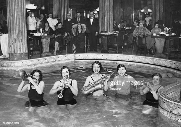 The Jazz Orchestra of the luxus bath LIDO DE PARIS playing in the swimming pool Paris About 1930 Photograph