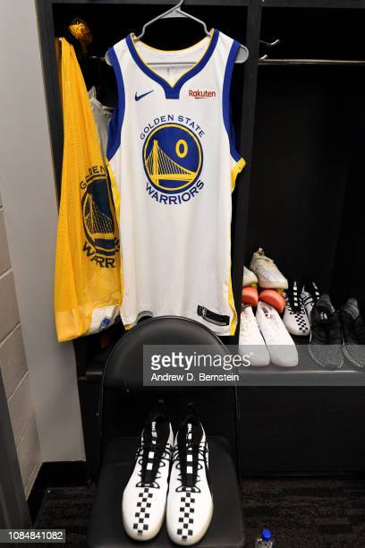The jersey and sneakers of DeMarcus Cousins of the Golden State Warriors are seen in the locker room prior to a game against the LA Clippers on...
