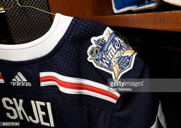 The jersey of Brady Skjei of the New York Rangers hangs in the locker room prior to the 2018 Bridgestone NHL Winter Classic between the New York...