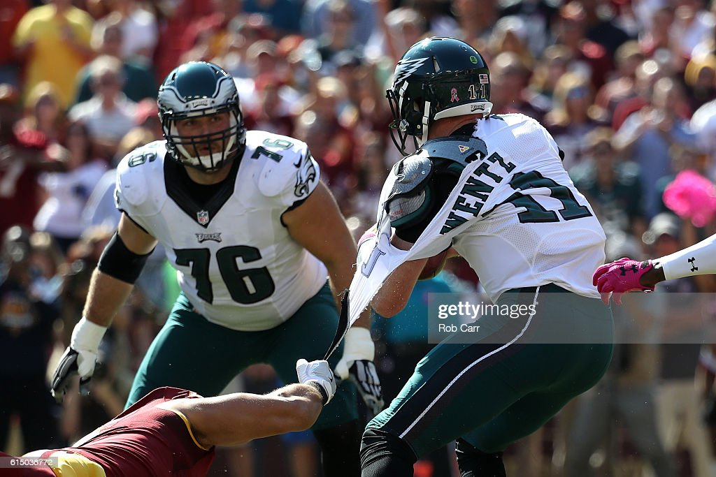 The jersey of quarterback Carson Wentz #11 of the Philadelphia Eagles is torn by outside linebacker Ryan Kerrigan #91 of the Washington Redskins in the first quarter at FedExField on October 16, 2016 in Landover, Maryland.