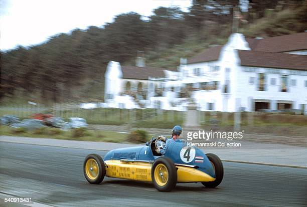 The Jersey Road Race St Helier May 8 1947 Prince B Bira correcting a slide onto the harbor front road in his Maserati 4CL painted in the colors of...