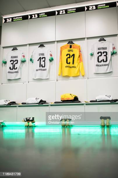 The jerseys of Florian Neuhaus Lars Stindl Tobias Sippel and Jonas Hofmann of Borussia Moenchengladbach are seen in the teamroom before the...