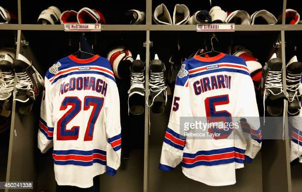 The jerseys of Ryan McDonagh and Dan Girardi of the New York Rangers hang in the locker room before Game Two of the 2014 Stanley Cup Final against...