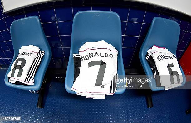 The jerseys of Toni Kroos Cristiano Ronaldo and Sami Khedira of Real Madrid are seen in the locker room prior to the FIFA Club World Cup Final...