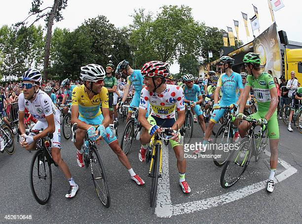 The jesey holders Thibaut Pinot of France and FDJ.fr in the best young rider's white jersey, Vincenzo Nibali of Italy and the Astana Pro Team in the...