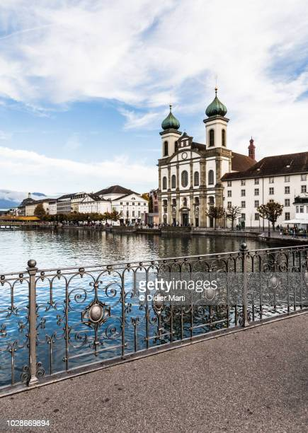 the jesuit church and the famous chapel bridge in lucern - ルツェルン ストックフォトと画像