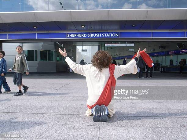 The Jesus of Shepherd's Bush. A Christian missionary in front of Shepherd's Bush tube station in west London. The tube station is next to the big...