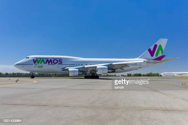 the jet of wamos air taxiing at boryspil airport, ukraine - taxiing stock pictures, royalty-free photos & images
